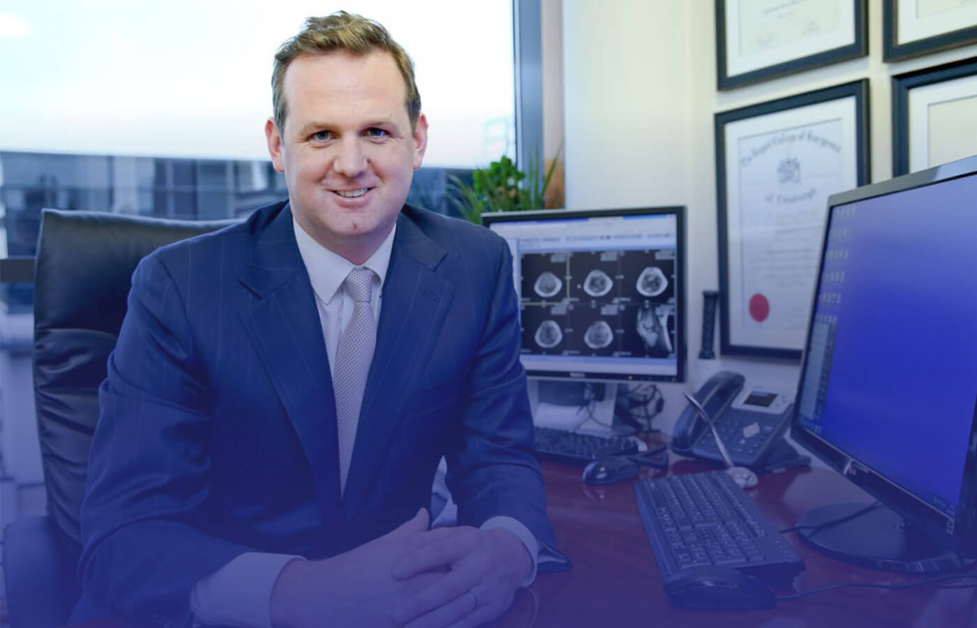 A photo of Professor Cathal Moran, knee and shoulder specialist, in office in Sports Surgery Clinic, Santry, Dublin